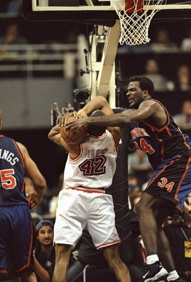 3 May 1998: Charles Oakley #34 of the New York Knicks in action against B.J. Brown #42 of the Miami Heat during a game at the Miami Arena in Miami, Florida. The Knicks defeated the Heat 98-81.