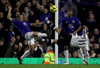 LIVERPOOL, ENGLAND - JANUARY 05:  Rafael Van der Vaart of Tottenham Hotspur competes with John Heitinga of Everton during the Barclays Premier League match between Everton and Tottenham Hotspur at Goodison Park on January 5, 2011 in Liverpool, England.  (