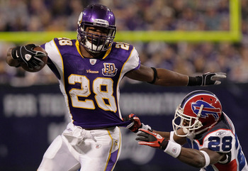MINNEAPOLIS, MN - DECEMBER 05:  Adrian Peterson #28 of the Minnesota Vikings rushes against  the Buffalo Bills at the Mall of America Field at the Hubert H. Humphrey Metrodome on December 5, 2010 in Minneapolis, Minnesota.  (Photo by Nick Laham/Getty Imag