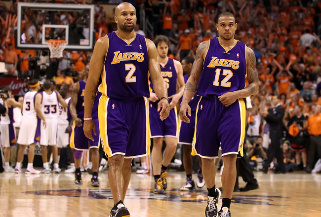 PHOENIX - MAY 23:  Derek Fisher #2 and Shannon Brown #12 of the Los Angeles Lakers walk off the court after being defeated by the Phoenix Suns in Game Three of the Western Conference finals of the 2010 NBA Playoffs at US Airways Center on May 23, 2010 in
