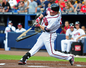 ATLANTA - JULY 27: Nate McLouth #13 of the Atlanta Braves breaks his bat while hitting against the Pittsburgh Pirates at Turner Field on July 27, 2011 in Atlanta, Georgia. (Photo by Scott Cunningham/Getty Images)