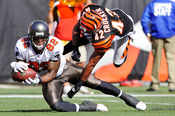 CINCINNATI, OH - OCTOBER 10:  Kellen Winslow #82 of the Tampa Bay Buccaneers pulls in a pass reception as Chris Crocker #42 of the Cincinnati Bengals defends at Paul Brown Stadium on October 10, 2010 in Cincinnati, Ohio.  (Photo by Jamie Sabau/Getty Image