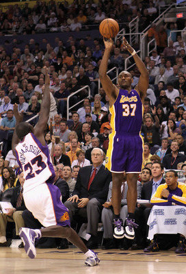 PHOENIX - MARCH 12:  Ron Artest #37 of the Los Angeles Lakers puts up a three point shot over Jason Richardson #23 of the Phoenix Suns during the NBA game at US Airways Center on March 12, 2010 in Phoenix, Arizona. The Lakers defeated the Suns 102-96. NOT