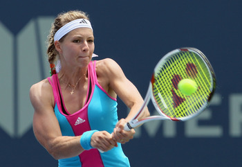 CARLSBAD, CA - AUGUST 02:  Maria Kirilenko of Russia returns a backhand to Rebecca Marino of Canada during the Mercury Insurance Open presented by Tri-City Medical at the La Costa Resort and Spa on August 2, 2011 in Carlsbad, California.  (Photo by Jeff G