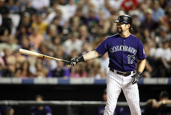 DENVER, CO - AUGUST 05: Todd Helton #17 of the Colorado Rockies hits against the Washington Nationals during their game at Coors Field August 5, 2011 in Denver, Colorado. The Washington Nationals won the game 5-3. (Photo by Marc Piscotty/Getty Images)
