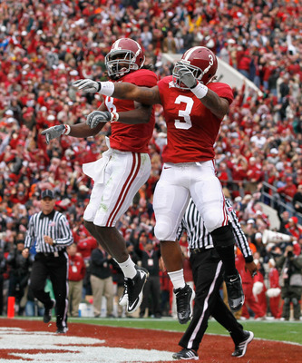 TUSCALOOSA, AL - NOVEMBER 26:  Julio Jones #8 and Trent Richardson #3 of the Alabama Crimson Tide reacts after Jones' touchdown against the Auburn Tigers at Bryant-Denny Stadium on November 26, 2010 in Tuscaloosa, Alabama.  (Photo by Kevin C. Cox/Getty Im