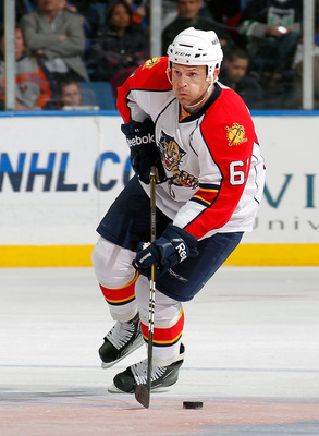UNIONDALE, NY - FEBRUARY 21:  Cory Stillman #61 of the Florida Panthers skates during an NHL hockey game against the New York Islanders at the Nassau Coliseum on February 21, 2011 in Uniondale, New York.  (Photo by Paul Bereswill/Getty Images)