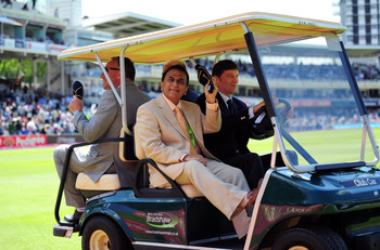 LONDON, ENGLAND - JULY 24:  Ex India captain Sunil Gavaskar waves to the crowd during a parade of past captains to mark the 100th test match between England and India during day four of the 1st npower test match between England and India at Lords on July