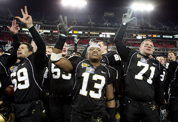 NASHVILLE, TN - DECEMBER 31: David Giller #69, Chris Marve #13 and Joey Bailey #71 of the Vanderbilt Commodores celebrate with the team after winning the Gaylord Hotels Music City Bowl against the Boston College Eagles at LP Field on December 31, 2008 in