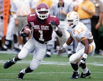 24 Sep 1994: Wide receiver Eric Moulds #1 of the Mississppi State Bulldogs avoids cornerback Terry Fair #13 of the Tennessee Volunteers during the Bulldogs 24-21 vcitory over the Volunteers at Scott Field in Starkville, Mississppi. Mandatory Credit: Jonat