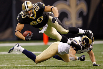 NEW ORLEANS, LA - DECEMBER 12:  Jimmy Graham #80 of the New Orleans Saints is tackled by Craig Dahl #43 of the St. Louis Rams at the Louisiana Superdome on December 12, 2010 in New Orleans, Louisiana.  (Photo by Chris Graythen/Getty Images)