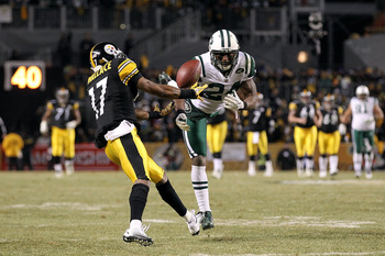 PITTSBURGH, PA - JANUARY 23:  Darrelle Revis #24 of the New York Jets breaks up a pass intended for Mike Wallace #17 of the Pittsburgh Steelers during the 2011 AFC Championship game at Heinz Field on January 23, 2011 in Pittsburgh, Pennsylvania. The Steel
