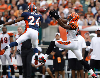 CINCINNATI, OH - AUGUST 15: Champ Bailey #24 of the Denver Broncos knocks away a pass intended for Terrell Owens #81 of the Cincinnati Bengals at Paul Brown Stadium on August 15, 2010 in Cincinnati, Ohio. The Bengals won 33-24. (Photo by Joe Robbins/Getty