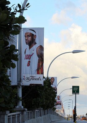 MIAMI, FL - JUNE 02:  A banner with the likeness of LeBron James #6 of the Miami Heat hangs outside the arena prior to Game Two of the 2011 NBA Finals between the Miami Heat and the Dallas Mavericks at American Airlines Arena on June 2, 2011 in Miami, Flo
