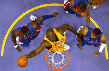 LOS ANGELES - JUNE 8:  Shaquille O'Neal #34 of the Los Angeles Lakers lays a shot up in Game 2 of the 2004 NBA Finals against the Detroit Pistons on June 8, 2004 at Staples Center in Los Angeles, California.  NOTE TO USER: User expressly acknowledges and