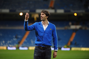 MADRID, SPAIN - JANUARY 24: Former Real Madrid striker Ruud Van Nistelrooy uses his phone to film fans applauding him at the Santiago Bernabeu stadium after  the La Liga match between Real Madrid and Malaga on Sunday January 24, 2010 in Madrid Spain. Van