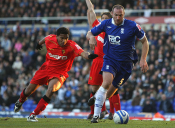 BIRMINGHAM, UNITED KINGDOM - DECEMBER 06:  Martin Taylor (R) of Birmingam gets around around Adrian Mariappa of Watford during the Coca Cola Championship match between Birmingham City and Watford at St Andrews on December 6, 2008 in Birmingham, England.