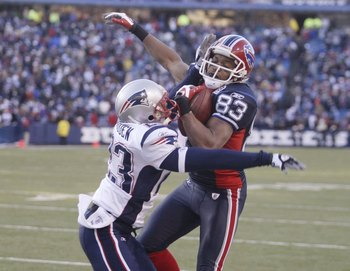 ORCHARD PARK, NY - DECEMBER 20: Lee Evans #83 of the Buffalo Bills makes a catch as Leigh Bodden #23 of the New England Patriots defends during the game at Ralph Wilson Stadium on December 20, 2009 in Orchard Park, New York. (Photo by: Rick Stewart/Getty