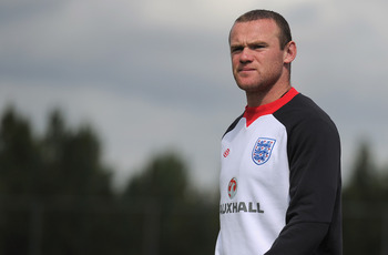 ST ALBANS, ENGLAND - AUGUST 09: Wayne Rooney looks on during the England training session at London Colney on August 9, 2011 in St Albans, England.  (Photo by Michael Regan/Getty Images)