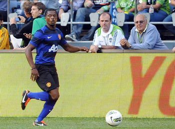 SEATTLE, WA - JULY 20: Patrice Evra #3 of Manchester United brings the ball up the field against the Seattle Sounders FC during the second half of the game at CenturyLink Field on July 20, 2011 in Seattle, Washington. (Photo by Steve Dykes/Getty Images)
