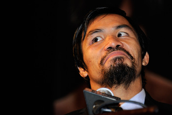 LAS VEGAS, NV - MAY 07:  Manny Pacquiao of the Philippines looks on during the post-fight news conference after Pacquiao defeated Shane Mosley by unanimous decision in the WBO welterweight title fight at MGM Grand Garden Arena on May 7, 2011 in Las Vegas,