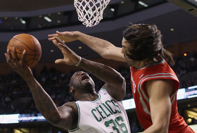 BOSTON, MA - JANUARY 10:  Shaquille O'Neal #36 of the Boston Celtics is fouled by Luis Scola #4 of the Houston Rockets on January 10, 2011 at the TD Garden in Boston, Massachusetts.  NOTE TO USER: User expressly acknowledges and agrees that, by downloadin