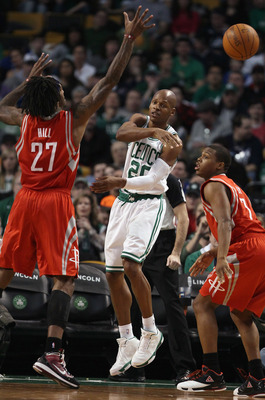 BOSTON, MA - JANUARY 10:  Ray Allen #20 of the Boston Celtics passes the ball as Kyle Lowry #7 and Jordan Hill #27 of the Houston Rockets defend on January 10, 2011 at the TD Garden in Boston, Massachusetts.  The Rockets defeated the Celtics 108-102. NOTE