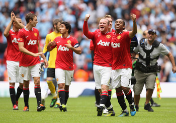 LONDON, ENGLAND - AUGUST 07:  Wayne Rooney of Manchester United celebrates with team mate Anderson after victory in the FA Community Shield match sponsored by McDonald's between Manchester City and Manchester United at Wembley Stadium on August 7, 2011 in