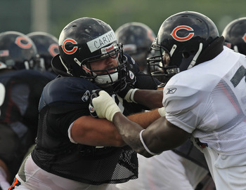 BOURBONNAIS, IL - AUGUST 06:  Gabe Carimi #72 of the Chicago Bears works against Israel Idonije #71 during a summer training camp practice at Olivet Nazarene University on August 6, 2011 in Bourbonnais, Illinois.  (Photo by Jonathan Daniel/Getty Images)