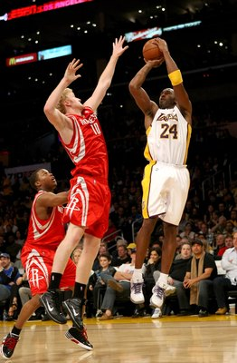 LOS ANGELES, CA - NOVEMBER 15:  Kobe Bryant #24 of the Los Angeles Lakers shoots over Chase Budinger #10 of the Houston Rockets on November 15, 2009 at Staples Center in Los Angeles, California.  The Rockets won 101-91.  NOTE TO USER: User expressly ackno