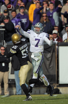BOULDER, CO - NOVEMBER 20:  Quarterback Collin Klein #7 of the Kansas State Wildcats delivers a pass agsinst the defense of Josh Hartigan #55 of the Colorado Buffaloes at Folsom Field on November 20, 2010 in Boulder, Colorado. Colorado defeated Kansas Sta