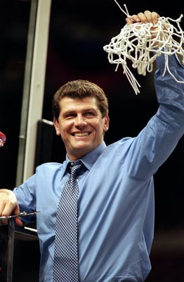 2 Apr 2000: Coach Geno Auriemma of the Connecticut Huskies takes down the net after winning the the NCAA Women''s Finals Four Game against the Tennessee Volunteers at the First Union Center in Philadelphia, Pennsylvania. The Huskies defeated the Volunteer