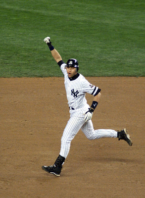 31 Oct 2001: Derek Jeter #2 of the New York Yankees celebrates his game winning home run in the 10th inning against the Arizona Diamondbacks during game four of the Major League Baseball World Series at Yankee Stadium in New York, New York. The Yankees de