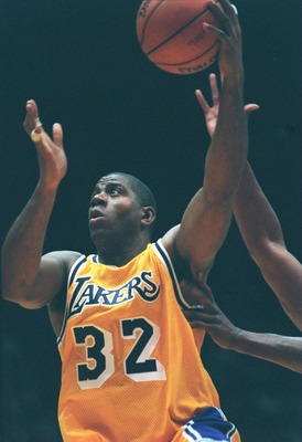 31 Jan 1996: Earvin Magic Johnson #32 of the Los Angeles Lakers drives to the basket in his return to the NBA during the game against the Golden State Warriors at the Great Western Forum in Inglewood, California.