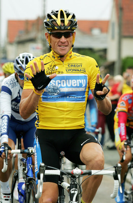 PARIS - JULY 24:  Lance Armstrong of the USA riding for the Discovery Channel team holds up 7 fingers which represents him winning a seventh consecutive Tour de France during Stage 21 of the Tour de France between Montereau and The Champs Elysees on July