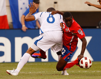 EAST RUTHERFORD, NJ - JUNE 18:  Joel Cambell #12 of Costa Rica gets wraped up with Wilson Palacios #8 of Honduras battling for possession during the 2011 Gold Cup Quarterfinals on June 18, 2011 at the New Meadowlands Stadium in East Rutherford, New Jersey