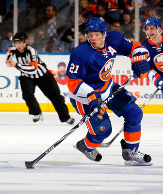 UNIONDALE, NY - FEBRUARY 05:  Kyle Okposo #21 of the New York Islanders skates during an NHL hockey game against the Ottawa Senators at Nassau Coliseum on February 5, 2011 in Uniondale, New York.  (Photo by Paul Bereswill/Getty Images)