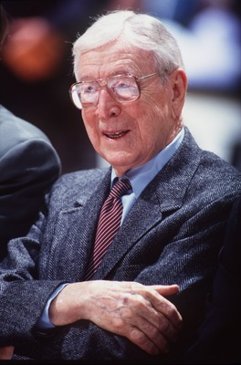 3 Dec 1994: FORMER UCLA HEAD BASKETBALL COACH JOHN WOODEN STANDS ON THE SIDELINES DURING THE WOODEN CLASSIC COLLEGE BASKETBALL TOURNAMENT AT THE POND IN ANAHEIM, CALIFORNIA.