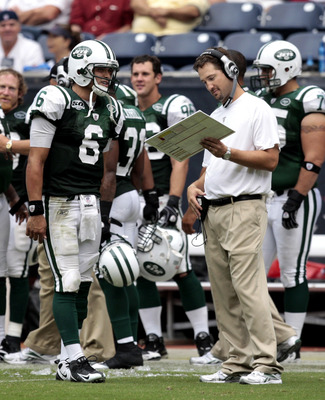 HOUSTON - SEPTEMBER 13:  Quarterback Mark Sanchez #6 of the New York Jets talks with offensive coordinator Brian Schottenheimer at Reliant Stadium on September 13, 2009 in Houston, Texas.  (Photo by Bob Levey/Getty Images)