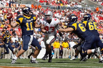 CLEVELAND - SEPTEMBER 19: Nathan Williams #43 of the Ohio State Buckeyes rushes quarterback Aaron Opelt #11 of the Toledo Rockets at Cleveland Browns Stadium on September 19, 2009 in Cleveland, Ohio. The Ohio State Buckeyes shutout the Toledo Rockets 38-0