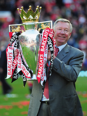 MANCHESTER, ENGLAND - MAY 22:  Sir Alex Ferguson manager of Manchester United lifts the Premier League trophy after the Barclays Premier League match between Manchester United and Blackpool at Old Trafford on May 22, 2011 in Manchester, England. Mancheste