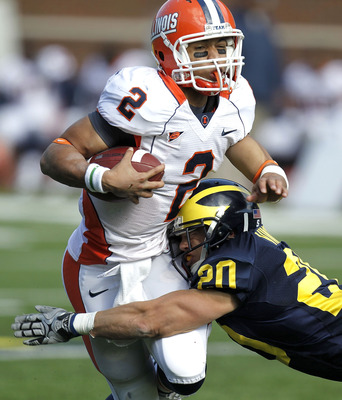ANN ARBOR, MI - NOVEMBER 06:  Nathan Scheelhaase #2 of the Illinios Fighting Illini is tackled by Ray Vinopal #20 of the Michigan Wolverines at Michigan Stadium on November 6, 2010 in Ann Arbor, Michigan. Michigan won the game 67-65.  (Photo by Gregory Sh