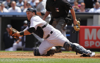 NEW YORK, NY - JULY 27:  Russell Martin #55 of the New York Yankees against the Seattle Mariners in the fifth inning on July 27, 2011 at Yankee Stadium in the Bronx borough of New York City.  (Photo by Nick Laham/Getty Images)