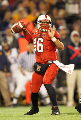 ORLANDO, FL - DECEMBER 28:  Russell Wilson #16 of the North Carolina State Wolfpack passes the ball during the Champs Sports Bowl against the West Virginia Mountineers at Florida Citrus Bowl Stadium on December 28, 2010 in Orlando, Florida.  (Photo by Mik