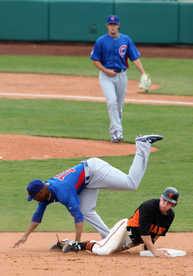 SCOTTSDALE, AZ - MARCH 01:  Gary Brown #86 of the San Francisco Giants safely steals second base under the tag from infielder Bobby Scales #19 of the Chicago Cubs during the spring training game at Scottsdale Stadium on March 1, 2011 in Scottsdale, Arizon