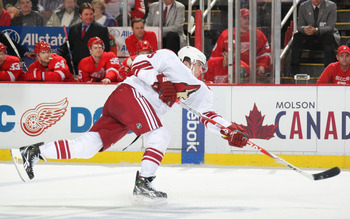 DETROIT, MI- APRIL 13:  Keith Yandle #3 of the Phoenix Coyotes shoots the puck against the Detroit Red Wings in Game One of the Western Conference Quarterfinals during the 2011 NHL Stanley Cup Playoffs at Joe Louis Arena on April 13, 2011 in Detroit, Mich