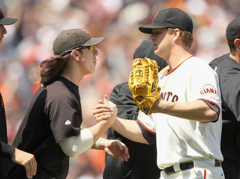 SAN FRANCISCO, CA - JUNE 08:  Matt Cain #18 of the San Francisco Giants is congratulated by Tim Lincecum #55 of the San Francisco Giants after they beat the Washington Nationals at AT&T Park on June 8, 2011 in San Francisco, California.  (Photo by Ezra Sh