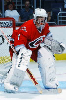 WASHINGTON D.C. - OCTOBER 4:  Goaltender Arturs Irbe #1 of the Carolina Hurricanes looks on against the Washington Capitals during the NHL preseason game on October 4, 2002 at the Air Canada Center in Toronto, Canada.  (Photo by Mitchell Layton/Getty Imag