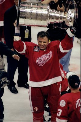 16 Jun 1998:  Viacheslav Fetisov #2 of the Detroit Red Wings holds up the Stanley Cup during the Stanley Cup Finals game against the Washington Capitals at the MCI Center in Washington, D. C.. The Red Wings defeated the Capitals 4-1. Mandatory Credit: Cra