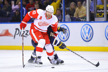 ST. LOUIS, MO - MARCH 12: Henrik Zetterberg #40 of the Detroit Red Wings moves the puck up ice against the St. Louis Blues at the Scottrade Center on March 12, 2011 in St. Louis, Missouri.  (Photo by Dilip Vishwanat/Getty Images)